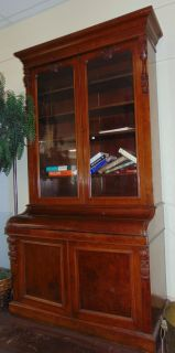 """19th Century English Mahogany Secretary Bookcase  Wonderful Antique English Mahogany Secretary Bookcase. Circa 1890. Tall, 2 piece cabinet with 2 door upper bookcase display. Slide-out leather writing surface. Center section raises up to create writing / reading slant top. Very special piece. Very Good Condition. Measures 94"""" tall x 54"""" wide x 25"""" deep. Must see. Starting Bid $50. Auction Estimate $500 - $700."""