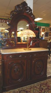 """Antique Renaissance Revival Walnut Marble Top Sideboard  Antique Renaissance Revival Carved Walnut Sideboard with Mirror and Marble Top. Circa 1880. Measures 89"""" tall x 53"""" wide x 19"""" deep. Condition is good. Minimal wear typical from age. Starting Bid $50. Auction Estimate $500 - $600."""