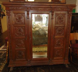 "Antique Italian Carved Walnut Armoire Antique Italian Carved Walnut Armoire. Circa 1880. 3 Doors. Measures 81"" tall x 82"" wide x 26"" deep. Condition is good with minimal wear. No damage. Starting Bid $50. Auction Estimate $300 - $400."