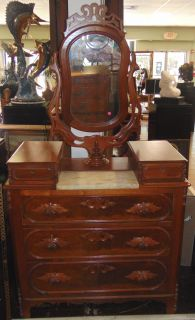 "Antique Walnut Eastlake Dresser with Mirror Antique Victorian Eastlake Gentlemans Dresser. Carved Walnut with Burl. Original Marble Top insert and Swivel Mirror. 3 Large Drawers with 2 small Vanity Drawers on top. Measures 41-1/2"" wide x 19-1/2"" deep x 75"" tall. Condition is Very good. Some minor wear and surface scratches typical from age. No Damage. Starting bid $50. Auction Estimate $150 - $250."