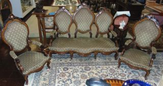 """3 piece Antique Carved Rosewood Parlour Set Beautiful 3 piece Antique Carved Rosewood Parlour Set. Circa 1890. Includes Sofa and 2 Side Chairs. Sofa measures 68"""" wide x 52"""" tall. Chairs each measure 49-1/2"""" tall x 26"""" wide. Condition is very good. Minimal surface wear. No damage. Starting Bid $50. Auction Estimate $1000 - $1200."""