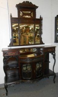 """Antique Victorian Etagere and Mirror Beautiful Antique 2 piece Mahogany Victorian Etagere. Circa 1900. Base unit Measures 53"""" wide x 42"""" tall x 18"""" deep. Display Cabinet is Velvet lined on top shelf. Separate Mirror measures 41"""" wide x 43"""" tall. Both pieces are in good condition with signs of wear and normal surface scratches. Starting Bid $50. Auction Estimate $350 - $500."""
