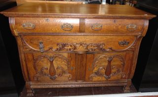 """Antique Oak Buffet Server Lovely Antique Victorian style Oak Buffet Server. 2 Lower Doors and 2 Drawers. Measures 36-1/2"""" tall x 48"""" wide x 24"""" deep. Condition is good with typical wear. Starting Bid $50. Auction Estimate $180 - $200."""