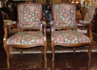 """Antique Pair of Carved Armchairs Pair (2) of Carved Armchairs. Each measures 40"""" tall x 24-1/2"""" wide x 25"""" deep. Condition is good with some minor wear. No damage. Starting Bid $50 for pair. Auction Estimate $200 - $250."""