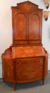 "Italian Inlaid Secretary Bookcase Cabinet Beautiful Italian Inlaid Secretary Bookcase Cabinet. Measures 88"" tall x 55"" wide x 20"" deep. Condition is very good. Some minor surface scratches and some fading from sun exposure. No additional Damage. Starting Bid $50. Auction Estimate $650 - $800."