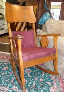 "Antique Golden Oak Rocking Chair Antique Golden Oak Rocking Chair. Circa 1900-1920. Measures 42"" tall x 24"" wide. Condition is good to fair with some wear and scratches typical from age. Starting Bid $40. Auction Estimate $40 - $50."