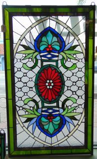 "Custom Stained Glass Hanging Panel Custom Hand Crafted Stained Glass Hanging Window Panel. Floral Design. Excellent quality. Measures 35"" tall x 20-1/2"" wide. Condition is New. No Damage. Starting Bid $50. Auction Estimate $100 - $150."