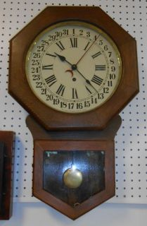 """Arthur Pequegnat Brandon Regulator Time & Calendar Clock Antique Arthur Pequegnat Brandon Regulator Time and Calendar Wall Clock. Measures 26"""" x 16"""". Made in Canada. Condition is good. No Damage. All Clocks are Sold as is. Starting bid $50. Auction Estimate $80 - $120."""