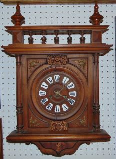 "Antique German Wall Clock Antique German Wall Clock. Measures 24"" tall x 15-1/2"" wide. Condition is good with minimal wear. Cracks in some moulding (see close up photos). All Clocks are Sold as is. Starting Bid $50. Auction Estimate $80 - $120."