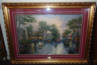 "Thomas Kinkade ""Carmel, Sunset on Ocean Avenue"" 1999 Thomas Kinkade ""Carmel, Sunset on Ocean Avenue"". Issued 1999. Beautifully Framed and Matted under glass. Frame measures 42-1/2"" tall x 56-1/2"" wide. Condition is very good. No Damage. Starting Bid $50. Auction Estimate $150 - $200."
