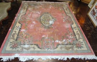 """8' x 10"""" Chinese Rug 8' x 10"""" Chinese Rug. Overall condition is good however there is much staining as well as minor wear. No tears or rips. Starting Bid $50. Auction Estimate $100 - $150."""