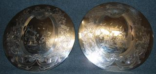 """Vintage Pair of English Silver Plated Trivets Falstaff Vintage Pair of English Silver Plated Trivets by Falstaff. Both Engraved with Neptune, Sea Creatures and Old World Ships Scenes. Sides are marked """"Falstaff Silverplated England"""". Bottom is felt lined. Each measures 9"""" in diameter. Condition is good with minimal wear. No damage. Starting Bid $30. Auction Estimate $30 - $40."""