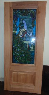 "36"" x 80"" Mahogany and Stained Glass Door with Peacocks New Mahogany and Stained Glass Door with Peacocks. Solid Core Mahogany, raised panel (raw, unfinished) Door. Stained Glass Panels are sandwiched between 2 tempered glass panels. Standard Size (36"" x 80""). Condition is Brand New, Mint. No Damage. Starting Bid $50. Auction Estimate $600 - $700."
