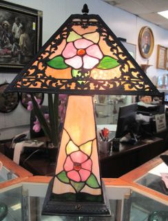 "Stained Glass Table Lamp Wonderful 4 sided Stained Glass Table Lamp. Beautiful Floral Pattern. Lights up Top, Bottom or Both. Measures 22"" tall x 13"" wide. Condition is Excellent. No damage. Starting bid $50. Auction Estimate $120 - $150."