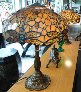 """Pair (2) of Stained Glass Dragonfly Table Lamps Pair (2) of Stained Glass Dragonfly Table Lamps. Each measures 24"""" tall. Shades are 17"""" wide. Condition is very good. No Damage. Starting Bid $50. Auction Estimate $400 - $500."""