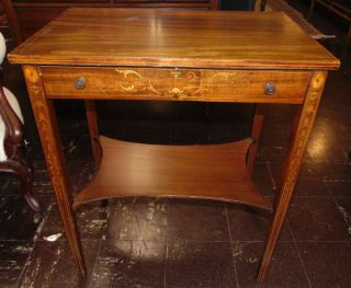 """Antique Inlaid Mahogany Side Table Antique Inlaid Mahogany Side Table. Circa 1940's. Measures 29"""" tall x 24"""" wide x 16"""" deep. Condition is good with minimal wear and minor surface scratches. Starting Bid $50. Auction Estimate $50 - $60."""