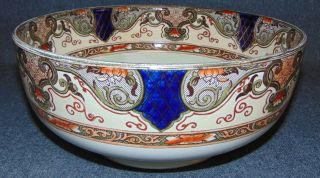 "Royal Doulton Series Ware Fruit Bowl Large Royal Doulton Series Ware Fruit Bowl by Izaak Walton. The ""Gallant Fishers"". Circa 1904. Measures 10-3/8"" wide x 4-1/2"" tall. Condition is very good. No Damage. Starting Bid $50. Auction Estimate $100 - $120."