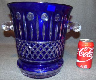 "Cobalt Blue European Cut Crystal Champagne Bucket Cobalt Blue European Cut Crystal Champagne or Ice Bucket. Heavy and Thick Lead Crystal. Measures 10"" tall x 12"" wide at the handles. Condition is New, Mint. No Damage. Starting Bid $50. Auction Estimate $250 - $300."