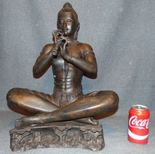 "Bronze Asian Bodhisattva Buddha Playing Flute  Bronze Asian Bodhisattva Buddha Playing Flute Sculpture. Measures 19"" tall x 15"" wide x 10"" deep. Condition is very good with minimal wear. This Sculpture is made entirely from Bronze. No damage. Starting Bid $50. Auction Estimate $250 - $350."