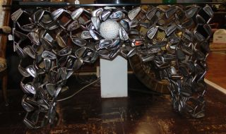 "Fabulous Golf Club Console Table by Jeff Diamond Custom Made Golf Club Console Table with Glass Top by Florida artist Jeff Diamond. Truly functional sculpture, this piece joins fine art with the art of golf by repurposing golf clubs into a striking accessory. Console has a large Golf ball on front of console. Stands 30-1/2"" tall. Glass top measures 49-1/2"" wide x 16"" deep. Condition is good with minimal wear. Some paint losses on Golf Ball. No damage."