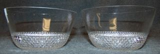"Pair of R. Lalique French Crystal ""Tokyo"" Finger Bowls Pair (2) of Vintage R. Lalique French Crystal ""Tokyo"" Finger Bowls. Circa 1930's. Each are signed ""R Lalique"". Art Deco motif of molded dots in concentric circles. Designed by Rene Lalique (1860-1945) in 1935. Each Bowl measures 2-3/8"" tall x 4-3/4"" wide. Overall condition is good with each having a minor flea bite chip (see close-up photos)."