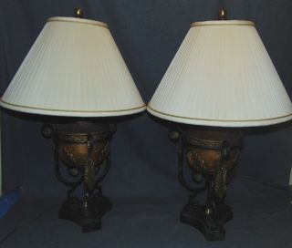 "Pair (2) of Maitland-Smith Table Lamps Pair (2) of Maitland-Smith Urn Form Table Lamps with Shades. Wrought Iron with a Marble Base. Each measures 33"" tall x 20"" wide. Overall condition is good with minor wear. Several Shipping Options Available. Starting Bid $150. Auction Estimate $300 - $400."