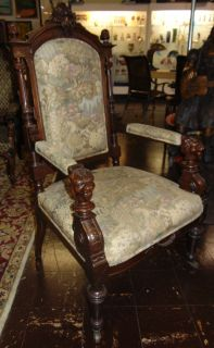 "Antique Carved Walnut Throne Chair Antique Victorian Carved Walnut Throne Chair with Original Petit Point Upholstery. This Beautiful Armchair measures 49"" tall x 28"" wide x 28"" deep. Condition is very good with minimal wear. No damage. Starting Bid $200. Auction Estimate $350 - $450."