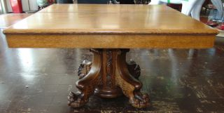 """Antique Golden Oak Pedestal Dining Table Antique Golden Oak Pedestal Dining Table. Circa 19th Century. Measures 30"""" tall x 50"""" wide x 50"""" deep. Includes 4 leaves. Each are 12"""" wide. Overall condition is very good with minor wear. No damage. Several Shipping Options Available. Starting Bid $350. Auction Estimate $600 - $700."""