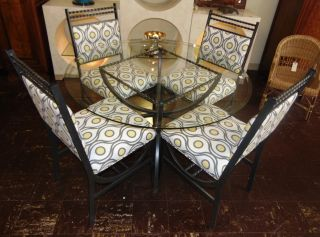 """Wrought Aluminum & Glass Top Table & 4 Chairs Wrought Aluminum Table with Round Glass Top & 4 matching Chairs. Table measures 29"""" tall x 48"""" wide. Condition is very good. Minimal wear. No damage. Several Shipping Options Available. Starting Bid $150. Auction Estimate $200 - $300."""