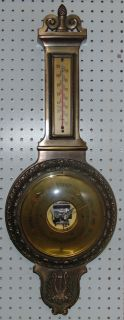 "Vintage West Wood Germany Brass Wall Barometer Vintage ""West Wood"" Brass Wall Barometer. Measures 30"" tall x 11"" wide. Condition is very good with minimal wear. No damage. Starting Bid $80. Auction Estimate $100 - $150."