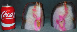 """Pair (2) of Large Brazilian Pink Agate Bookends  Pair (2) of Large Brazilian Pink Polished Agate Bookends. Each stands 6"""" tall. Condition is Mint. No Damage. Starting Bid $60. Auction Estimate $70 - $90."""