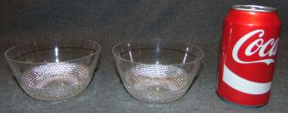 """Pair of R. Lalique French Crystal """"Tokyo"""" Finger Bowls Pair (2) of Vintage R. Lalique French Crystal """"Tokyo"""" Finger Bowls. Circa 1930's. Each are signed """"R Lalique"""". Art Deco motif of molded dots in concentric circles. Designed by Rene Lalique (1860-1945) in 1935. Each Bowl measures 2-3/8"""" tall x 4-3/4"""" wide. Overall condition is good with each having a minor flea bite chip (see close-up photos). Starting Bid $40 for the pair. Auction Estimate $40 - $60."""