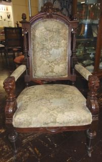 "Antique Carved Walnut Throne Chair 1900 Antique Victorian Carved Walnut Throne Chair with Original Petit Point Upholstery. This Beautiful Armchair measures 49"" tall x 28"" wide x 28"" deep. Condition is very good with minimal wear. No damage. Several Shipping Options Available. Starting Bid $300. Auction Estimate $350 - $450."