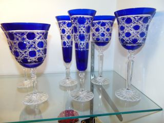 "6 Cobalt Blue Cut to Clear Crystal Glasses 6 Cobalt Blue Cut to Clear Crystal Glasses. 2 Wine, 2 Champagne and 2 Water. Heavy and high quality European Leaded Crystal. Wine & Champagne glasses measure 9"" tall each. Water is 7-3/4"". Condition is New, Mint. No Damage. Includes Fitted and lined Gift Box. Several Shipping Options Available. Starting Bid $180. Auction Estimate $200 - $250."