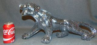 "Mirrored Glass Panther Sculpture By Jobi Mirrored Glass Panther Sculpture By Jobi. Made of mirrored glass mosaic. Hand Made In Brazil By The Artist Jobi. Measures 10-1/2"" tall x 20"" long. Overall condition is good. Wear consistent with age and use. Few spots of glued repair shows. Several Shipping Options Available. Starting Bid $50. Auction Estimate $60 - $80."