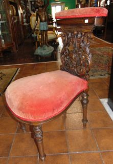 """Antique Carved Walnut Prie Dieu Prayer Chair Unusual & Rare, Antique Carved Walnut """"Prie Dieu"""" Prayer Chair with Red Velvet Upholstery. Circa 1880's. Heavily carved. Padded back rest opens up to reveal compartment. Stands 34"""" tall x 18"""" wide x 24"""" deep. Condition is fair to good with some wear, scratches as well as a repair (see close-ups). Several Shipping Options Available. Starting Bid $100. Auction Estimate $120 - $150."""
