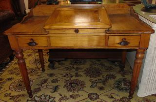 "Antique Oak Writing Desk Circa 1900 Antique Golden Oak Writing Desk Circa 1900. Measures 35"" tall x 47-1/2"" wide x 26"" deep. Overall condition is good with minor wear. Several Shipping Options Available. Starting Bid $200. Auction Estimate $220 - $300."