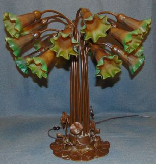 """Tiffany Style 18 Light Lily Table Lamp Tiffany Style 18 Light Lily Table Lamp. Measures 22"""" tall x 24"""" wide. Overall condition is Excellent. No Damage at all. Several Shipping Options Available. Starting Bid $300. Auction Estimate $350 - $400."""