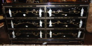 """Chinese Painted Lacquer 6 Drawer Dresser Mother of Pearl  Chinese Painted Lacquer 6 Drawer Dresser with applied Mother of Pearl. Measures 34"""" tall x 60"""" wide x 18"""" deep. Condition is good with some wear and surface scratches. Several Shipping Options Available. Starting Bid $100. Auction Estimate $120 - $130."""