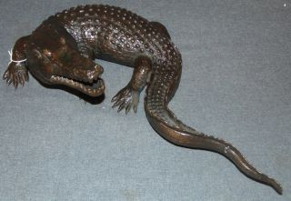 "Bronze Alligator Sculpture Bronze Alligator Sculpture. Measures 22"" long x 12"" wide. Condition is New, Mint. No Damage. This Sculpture is made entirely from Bronze. Several Shipping Options Available. Starting Bid $200. Auction Estimate $220 - $250."