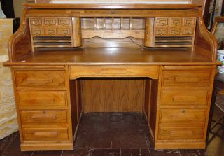 """Oak Roll Top Desk  Vintage Oak Roll Top Desk. Lots of Drawers & Storage. Measures 45"""" tall x 60"""" wide x 28-1/2"""" deep. Overall condition is good with minor wear. Several Shipping Options Available. Starting Bid $300. Auction Estimate $350 - $450."""