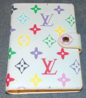 """Vintage Louis Vuitton Multi Color Monogram Address Book Vintage & Authentic, Louis Vuitton Monogram """"Carnet de Bal"""" Mini Address Book. Includes Original Box and Dust Cover. Leather Book measures 6"""" tall x 4"""" wide. Overall condition is very good. Box is slightly worn. Separation in seam (see close-up photo). Several Shipping Options Available. Starting Bid $100. Auction Estimate $120 - $150."""