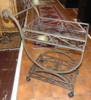 """Wrought Iron & Glass Tea Cart Wrought Iron & Glass Tea Cart. Measures 35"""" tall x 28"""" wide x 15"""" deep. 2 Glass shelves. Condition is Like New. Very good. No Damage. Several Shipping Options Available. Starting Bid $100. Auction Estimate $120 - $150."""