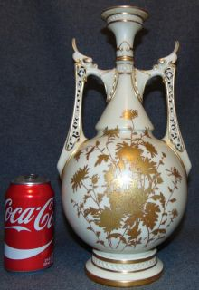 """Ivory Royal Worcester 2 Handled Vase Ivory Royal Worcester 2 Handled Vase. Shape 1071, date code c.1888. Bottom is signed. Measures 14"""" tall x 7-1/2"""" wide. Overall condition is Excellent. No Damage. Bottom Drilled for lamp. Starting Bid $70. Auction Estimate $80 - $120."""