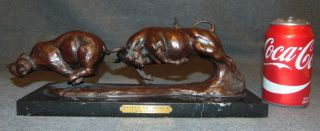 "Bullish on America Bronze Sculpture Dan Coates Bullish on America Bronze Sculpture on a Black Marble Base by Dan Coates. Signed. Measures 13-1/2"" wide x 4"" deep x 5"" tall. Condition is very good with minimal wear. No damage. Starting Bid $250. Auction Estimate $300 - $350."