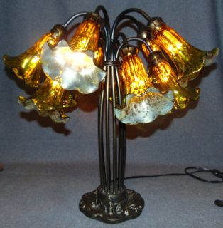 """Tiffany Style 10 Light Lily Table Lamp Tiffany Style 10 Light Lily Table Lamp. Measures 21"""" tall x 21"""" wide. Overall condition is Excellent. No Damage. Several Shipping Options Available. Starting Bid $150. Auction Estimate $160 - $200."""