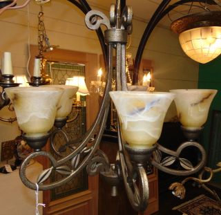 """Wrought Iron 5 Light Chandelier Wrought Iron 5 Light Chandelier with Art Glass Globes. Measures 25"""" x 25"""". Condition is very good. No Damage. Several Shipping Options Available. Starting Bid $100. Auction Estimate $120 - $150."""