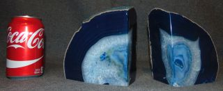 "Large Brazilian Dyed Agate Bookends Pair (2) of Large Brazilian Polished Agate Bookends. Each stands 6"" tall x 5-1/2"" wide. Condition is Mint. No Damage. Starting Bid $80. Auction Estimate $100 - $120."