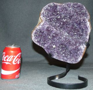 "Large Amethyst Crystal Geode on Iron Stand 12-1/2"" Beautiful & Large Brazilian Amethyst Crystal Geode on Iron Stand. Measures 12-1/2"" tall x 9"" wide. Condition is very good. New condition. No Damage. Several Shipping Options Available. Starting Bid $260. Auction Estimate $280 - $350."