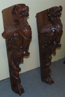"Pair of Large Architectural Carved Walnut Griffins Pair of Large Architectural Carved Walnut Griffins. 19th century. Each measures 37-1/2"" tall x 12"" wide x 14"" deep. Overall condition is fair to good. Shows age. Several Shipping Options Available. Starting Bid $500. Auction Estimate $600 - $700."